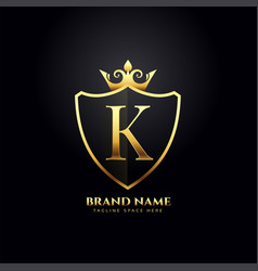 Letter k luxury logo concept with golden crown vector