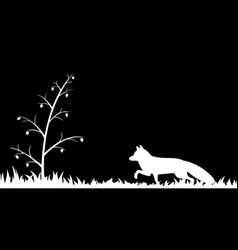 silhouette of fox in the grass vector image
