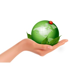 Green world and leaf have love bug in woman hand vector image vector image