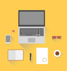 Laptop smartphone notepad glasses and a cup of vector