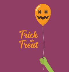 Green zombie hand holding scary air balloon vector