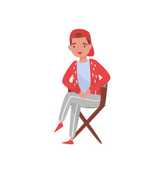young movie producer or filmmaker sitting in vector image