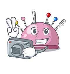 Photographer sewing pins and pincushion on mascot vector