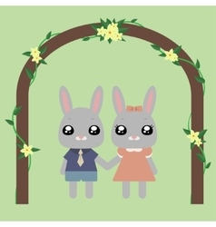Lovely bunnies under arch vector