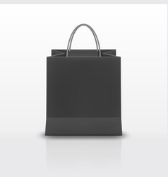 realistic black paper shopping bag with handles vector image