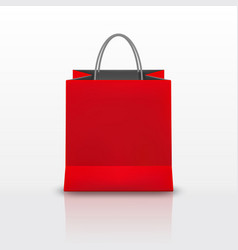 realistic red paper shopping bag with handles vector image
