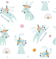 seamless pattern with cute jumping rabbits vector image