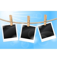 Photos hanging on a clothesline vector image
