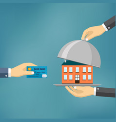 hands holding credit card and cloche with house vector image vector image