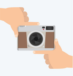 Flat style vintage camera with hands frame vector