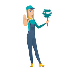 Caucasian mechanic holding stop road sign vector