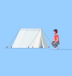 man hiker camper installing a tent preparing vector image