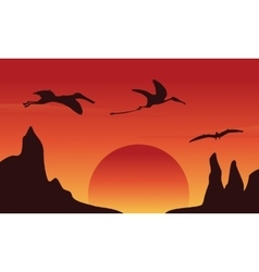 Silhouette of dinosaur pterodactyl at sunset vector