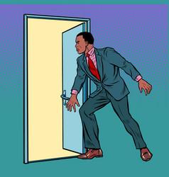 african man opens door vector image