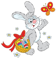 Easter Bunny carries a basket of eggs vector image vector image