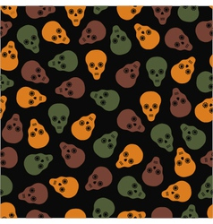 seamless pattern of skulls on a dark background vector image
