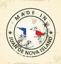 Stamp with map flag of Juan de Nova Island vector