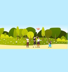 Children launching kite mix race kids wearing vector