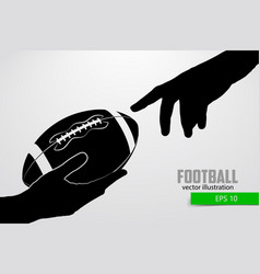 hand holds the rugby ball silhouette vector image