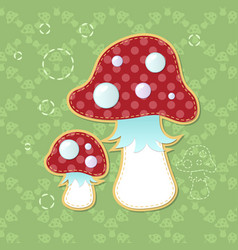 Two beautiful poisonous fly agarics on a green vector