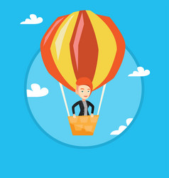 Young woman flying in hot air balloon vector