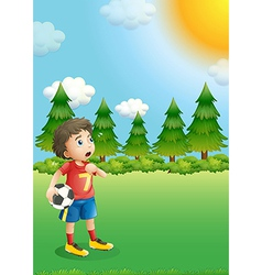 A young football player at the hill vector image