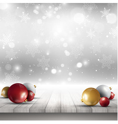 Christmas baubles on wooden deck vector