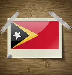 Flags East Timor at frame on wooden texture vector image