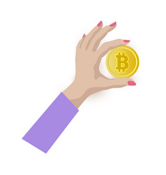 Female hand holding bitcoin golden coin in fingers vector
