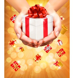 Holiday background with hands holding gift boxes vector image
