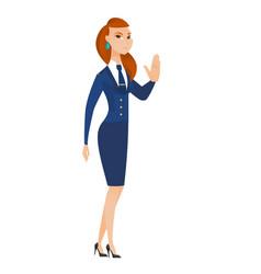 Caucasian stewardess showing stop hand gesture vector