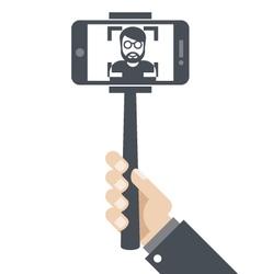 Hand with smartphone on selfie stick vector