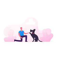 Happy man playing with dog on street in park vector