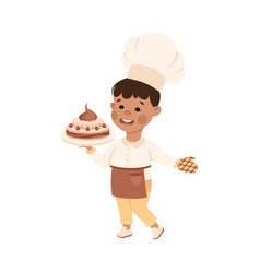 Cheerful boy in apron holding cake depicting chef vector