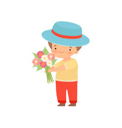 Lovely little boy in hat standing with bouquet of vector