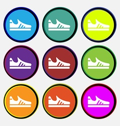 Running shoe icon sign Nine multi colored round vector image