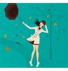 woman with umbrella in park in autumn vector image