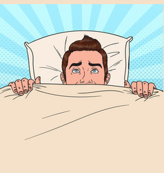 Pop art man hiding in bed scared guy vector