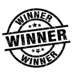 winner round grunge black stamp vector image vector image