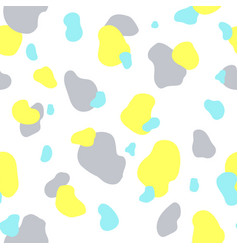 Seamless pattern of yellow gray and mint spots vector