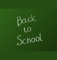 white inscription back to school on a green board vector image