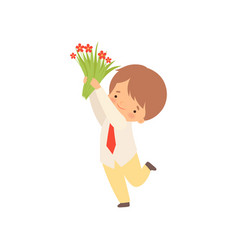 Cute little boy standing with bouquet red vector