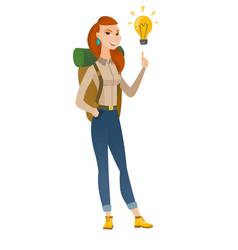 traveler pointing at bright idea light bulb vector image vector image
