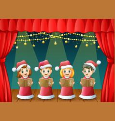 cartoon children in red santa costume singing chri vector image