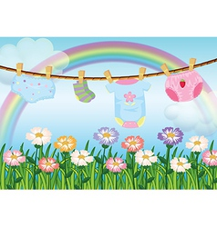 A garden with hanging baby clothes vector