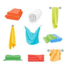 cartoon color folded towels set for bathroom vector image