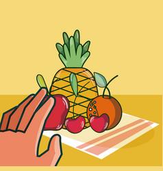 Hand grabbing fruits vector