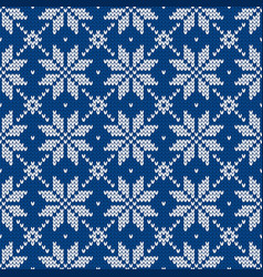 Scandinavian knitted sweater with snowflakes vector