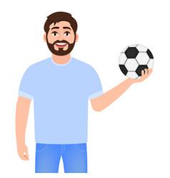 Man holding a soccer ball happy bearded man vector