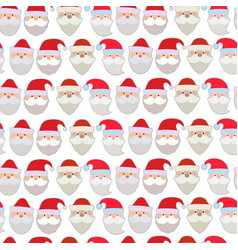 seamless pattern of the faces of santa vector image